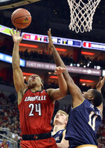 Louisville forward Dwayne Sutton (24) shoots over the reach of Notre Dame forward Juwan Durham (11) during the second half of an NCAA college basketball game in Louisville, Ky., Sunday, March 3, 2019. Louisville won 75-61. (AP Photo/Timothy D. Easley)