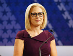 FILE - In this Oct. 15, 2018 file photo, U.S. Rep. Kyrsten Sinema, D-Ariz., goes over the rules in a television studio prior to a televised debate with U.S. Rep. Martha McSally, R-Ariz., in Phoenix. Sinema won Arizona's open U.S. Senate seat Monday, Nov. 12, in a race that was among the most closely watched in the nation, beating Republican Rep. Martha McSally in the battle to replace GOP Sen. Jeff Flake. (AP Photo/Matt York, File)