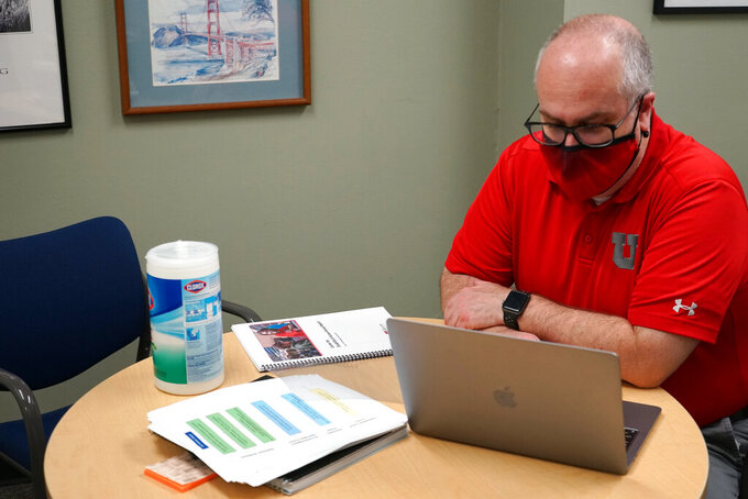 Scott McAward, director of the University of Utah's Center for Disability and Access, is shown in an undated photo. McAward said he's seen some students with disabilities who were able to return to finish degree programs with online learning options during the pandemic. (Emily Means/KUER via AP)