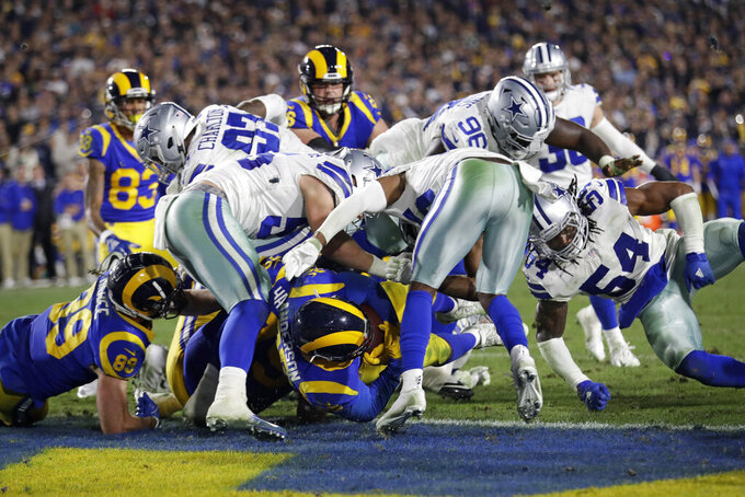 Los Angeles Rams running back C.J. Anderson scores against the Dallas Cowboys during the second half in an NFL divisional football playoff game Saturday, Jan. 12, 2019, in Los Angeles. (AP Photo/Marcio Jose Sanchez)
