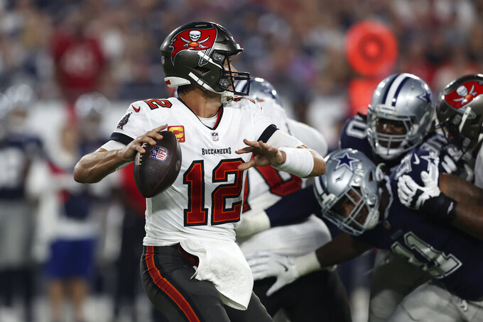 Tampa Bay Buccaneers quarterback Tom Brady (12) looks to pass against the Dallas Cowboys during the first half of an NFL football game Thursday, Sept. 9, 2021, in Tampa, Fla. (AP Photo/Mark LoMoglio)