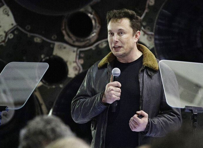 FILE - In this Sept. 17, 2018 file photo, SpaceX founder and chief executive Elon Musk speaks at an event to announce the name of the person who would be the first private passenger on a trip around the moon, in Hawthorne, Calif. SpaceX will lay off 10 percent of its roughly 6,000 workers, announcing Friday, Jan. 11, 2019, that it needs to become leaner to accomplish ambitious projects such as creating a spaceship that can carry astronauts to Mars. (AP Photo/Chris Carlson, File)