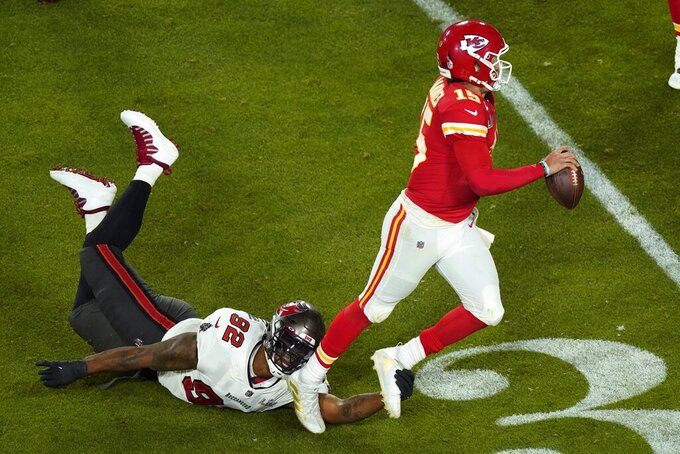 Kansas City Chiefs quarterback Patrick Mahomes (15) is tripped up by Tampa Bay Buccaneers' William Gholston (92) during the second half of the NFL Super Bowl 55 football game Sunday, Feb. 7, 2021, in Tampa, Fla. (AP Photo/Charlie Riedel)