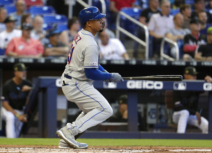 New York Mets' Carlos Gomez hits into a double play during the second inning of the team's baseball game against the Miami Marlins, Friday, May 17, 2019, in Miami. (AP Photo/Lynne Sladky)