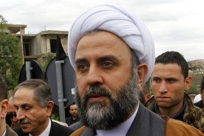 In this January 26, 2010, Sheik Nabil Qaouk a member of Hezbollah's Central Council, attends the funeral of prominent businessman Hassan Tajeddine, in the southern village of Hanaway, Lebanon.  On Friday, Oct. 23, 2020, the U.S. Treasury has sanctioned two high-ranking Hezbollah officials,  Nabil Qaouk and Hassan al-Baghdadi, both members of Hezbollah's Central Council. The Council is responsible for electing members of the group's top decision-making body, the Shura Council.  (AP Photo/Hussein Malla)