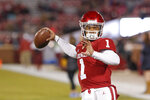 FILE - In this Saturday, Nov. 17, 2018 file photo, Oklahoma quarterback Kyler Murray (1) warms up before the start of an NCAA college football game against Kansas in Norman, Okla. No. 6 West Virginia and No. 12 Oklahoma meet Friday night in Morgantown, W.Va., with the winner earning a berth in the Big 12 championship game next week.  (AP Photo/Alonzo Adams, File)