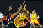 Seattle Storm forward Breanna Stewart (30) gets between Las Vegas Aces center A'ja Wilson (22) and forward Cierra Burdick (11) during the second half of Game 3 of basketball's WNBA Finals Tuesday, Oct. 6, 2020, in Bradenton, Fla. (AP Photo/Chris O'Meara)