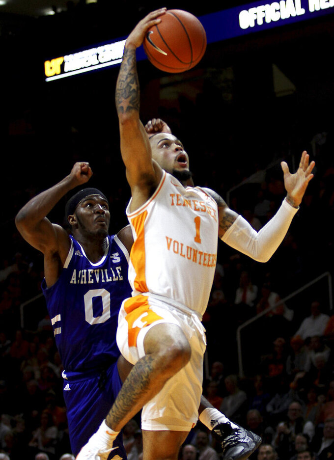 Tennessee's Lamonte Turner drives for a dunk in the lane against UNC Asheville's Trent Stephney during an NCAA college basketball game Tuesday, Nov. 5, 2019, in Knoxville, Tenn. (Tom Sherlin/The Daily Times via AP)