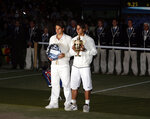 FILE - In this Sunday, July 6, 2008 file photo Spain's Rafael Nadal right, stands with the winners trophy next to Switzerland's Roger Federer after the men's singles final on the Centre Court at Wimbledon. After going more than 1½ years without playing each other anywhere, Roger Federer and Rafael Nadal will be meeting at a second consecutive Grand Slam tournament when they face off in Wimbledon's semifinals. (AP Photo/Kirsty Wigglesworth, File)