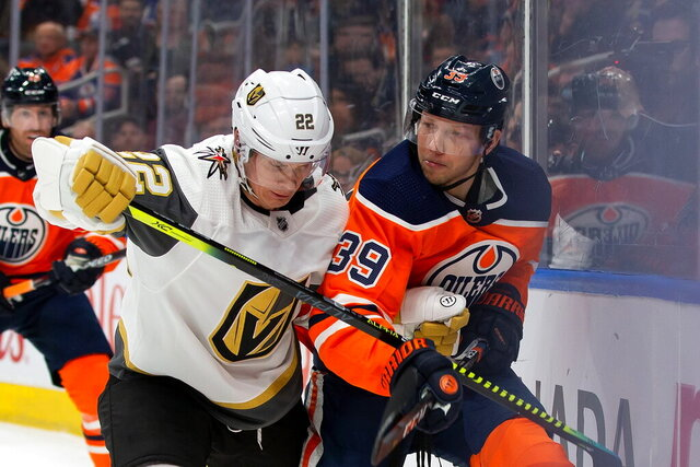 Edmonton Oilers' Alex Chiasson (39) jostles with Vegas Golden Knights' Nick Holden (22) during second-period NHL hockey game action in Edmonton, Alberta, Monday, March 9, 2020. (Codie McLachlan/The Canadian Press via AP)