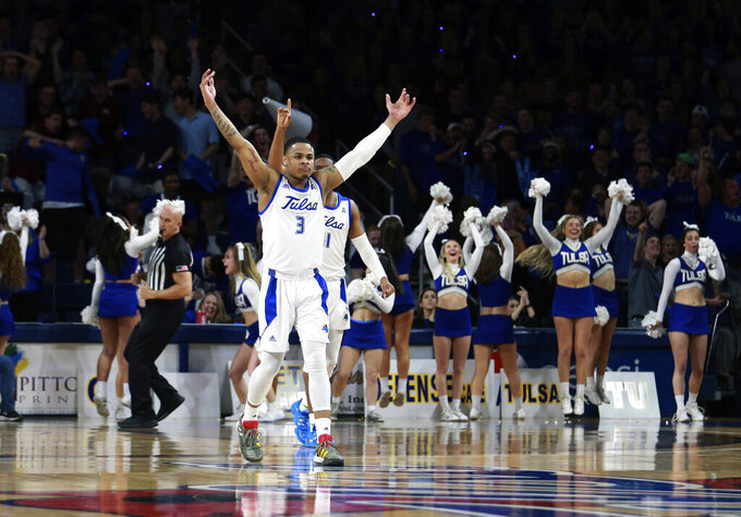 Tulsa guard Elijah Joiner (3) celebrates a three pointer against Wichita State in the second half of Tulsa's 54-51 win over Wichita State in an NCAA college basketball game in Tulsa, Okla., Saturday, Feb. 1, 2020. (AP Photo/Joey Johnson)