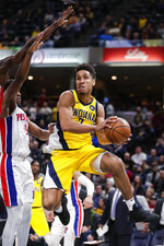 Indiana Pacers guard Malcolm Brogdon (7) looks to pass the ball in front of Detroit Pistons guard Langston Galloway (9) during the second half of an NBA basketball game in Indianapolis, Friday, Nov. 8, 2019. The Pacers won 112-106. (AP Photo/Michael Conroy)