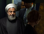 Iran's President Hassan Rouhani walks towards the podium before addressing the 74th session of the United Nations General Assembly, Wednesday, Sept. 25, 2019. (AP Photo/Craig Ruttle)