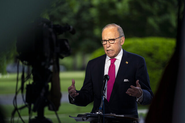 FILE - In this May 8, 2020, file photo White House chief economic adviser Larry Kudlow speaks during an interview on the unemployment numbers caused by the coronavirus, at the White House in Washington. Some of Trump's top economic advisers emphasized on Sunday, May 10, the importance of states getting more businesses and offices open. (AP Photo/Evan Vucci, File)