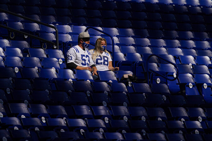 Fans sit in the stands before an NFL football game between the New York Jets and the Indianapolis Colts in Indianapolis, Sunday, Sept. 27, 2020. 7,500 fans were admitted to the game. (AP Photo/Darron Cummings)