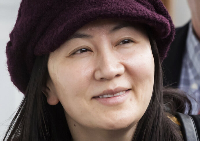 FILE - In this March 6, 2019, file photo, Huawei chief financial officer Meng Wanzhou arrives back at her home after a court appearance in Vancouver, British Columbia. The first stage of her extradition hearing begins Monday, Jan. 20, 2020, in a Vancouver courtroom, a case that has infuriated Beijing, set off a diplomatic furor and raised fears of a brewing tech war between China and the United States. (Darryl Dyck/The Canadian Press via AP, File )