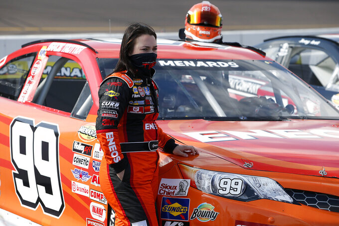 Gracie Trotter stands by her race car on pit road prior to the ARCA Series auto race at Phoenix Raceway, Saturday, Nov. 7, 2020, in Avondale, Ariz. (AP Photo/Ralph Freso)