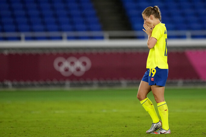 Sweden's Anna Anvegard reacts after missing a chance to score in a penalty shootout against Canada during the women's final soccer match at the 2020 Summer Olympics, Friday, Aug. 6, 2021, in Yokohama, Japan. (AP Photo/Andre Penner)