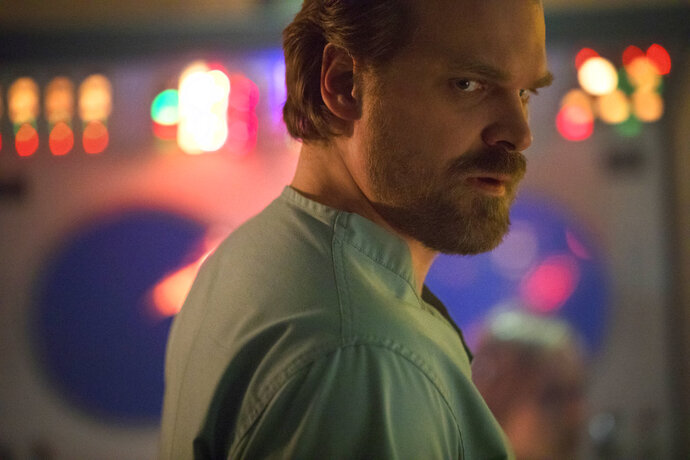 This image released by Netflix shows David Harbour in a scene from