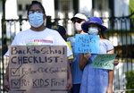Students and parents gather outside the Governor's Mansion to urge Gov. Greg Abbott to drop his opposition to public school mask mandates, Monday, Aug. 16, 2021, in Austin, Texas. The Texas Supreme Court has blocked mask mandates ordered by two of the nation's largest counties that defied Republican Gov. Greg Abbott as COVID-19 cases surge. (AP Photo/Eric Gay)