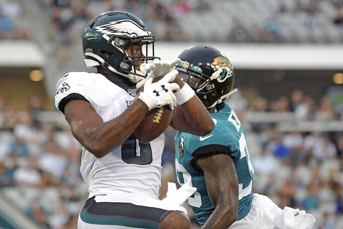 Philadelphia Eagles wide receiver Greg Ward, left, makes a reception in front of Jacksonville Jaguars defensive back C.J. Reavis for a 38-yard touchdown play during the first half of an NFL preseason football game, Thursday, Aug. 15, 2019, in Jacksonville, Fla. (AP Photo/Phelan M. Ebenhack)