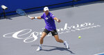Springfield Laser player Mitchell Krueger returns a serve at the start of the Worldteam Tennis tournament at The Greenbrier Resort Sunday July 12, 2020, in White Sulphur Springs, W.Va. (AP Photo/Steve Helber)
