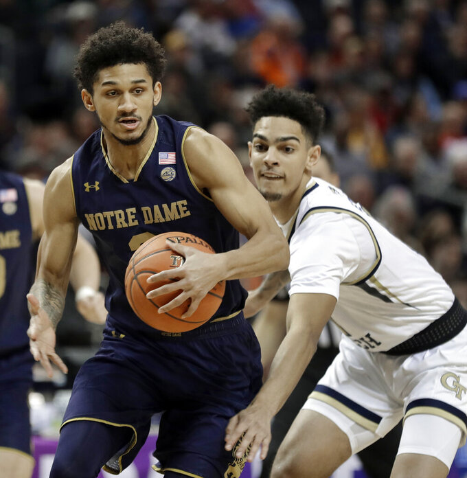 Notre Dame's Prentiss Hubb, left, drives past Georgia Tech's Jose Alvarado, right, during the first half of an NCAA college basketball game in the Atlantic Coast Conference tournament in Charlotte, N.C., Tuesday, March 12, 2019. (AP Photo/Nell Redmond)