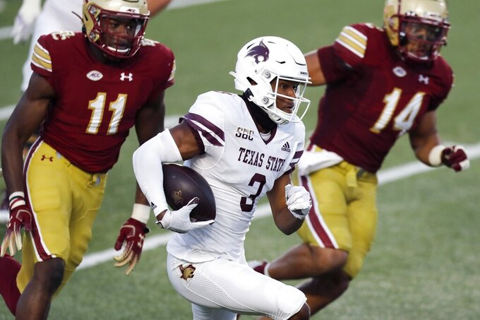 Texas State wide receiver Jeremiah Haydel (3) carries the ball in front of Boston College defensive end Shitta Sillah (11) and linebacker Max Richardson (14) during the first half of an NCAA college football game Saturday, Sept. 26, 2020, in Boston. (AP Photo/Michael Dwyer)