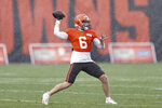 FILE - Cleveland Browns quarterback Baker Mayfield throws a pass during practice at the NFL football team's training facility Monday, Aug. 17, 2020, in Berea, Ohio. It's all about the quarterbacks in the AFC North. (AP Photo/Ron Schwane, File)