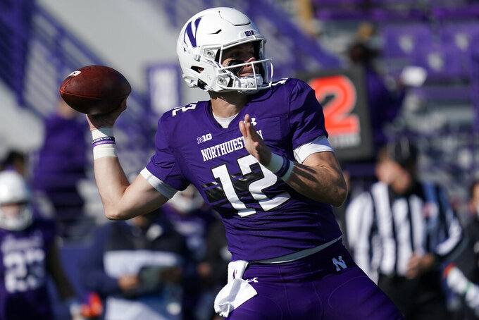 Northwestern quarterback Ryan Hilinski throws a pass against Rutgers during the first half of an NCAA college football game in Evanston, Ill., Saturday, Oct. 16, 2021. (AP Photo/Nam Y. Huh)