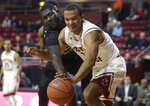 Florida State's Christ Koumadje, left, and Boston College's Steffon Mitchell, right, vie for control of the ball in the first half of an NCAA college basketball game, Sunday, Jan. 20, 2019, in Boston. (AP Photo/Steven Senne)