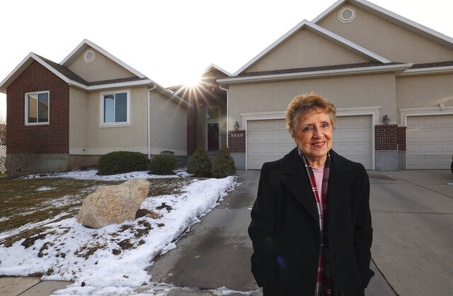 Madelene Lee poses for a photo outside of her home in West Jordan, Utah, on Wednesday, Dec. 16, 2020. She and her husband supplement their income by renting out their basement to a couple and by hosting foreign exchange students. (Scott G Winterton/The Deseret News via AP)