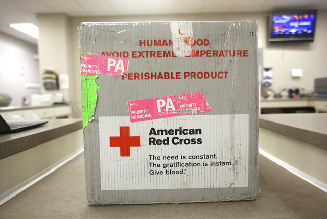 FILE - This Monday, March 9, 2020 file photo shows donated blood in a transportation case at The American Red Cross donation center in Scranton, Pa. Due to the flu season and coronavirus, donations to The American Red Cross are down across the country. (Jake Danna Stevens/The Times-Tribune via AP)