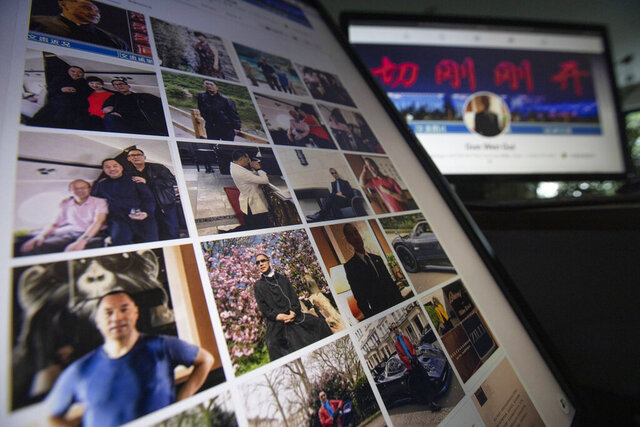 "Facebook pages from Guo Wengui's account are seen on computer screens in Beijing on Friday, Aug. 21, 2020. The self-exiled Chinese tycoon on whose 150-foot (45-meter) yacht President Donald Trump's former chief strategist, Steve Bannon, was arrested is a high-profile irritant to the ruling Communist Party. In June, Guo and Bannon announced the founding of the ""Federal State of New China,"" an initiative to ""overthrow the Chinese government.""  (AP Photo/Ng Han Guan)"