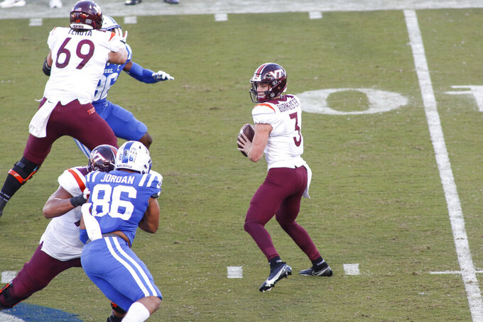 Virginia Tech quarterback Braxton Burmeister (3) looks to pass against Duke during the first half of an NCAA college football game, Saturday, Oct. 3, 2020, in Durham, N.C.  (Nell Redmond/Pool Photo via AP)