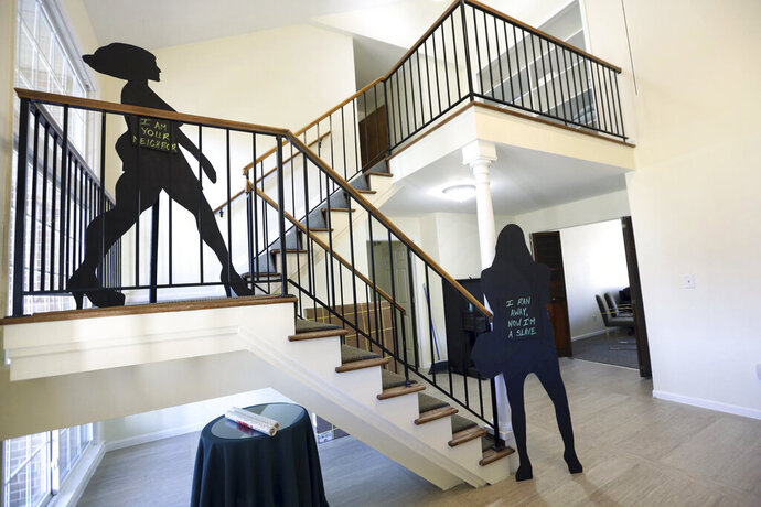 FILE - In this Dec. 1, 2017 file photo, silhouettes telling the stories of survivors are placed along the stairs leading to the second floor at the Sanctum House, a shelter for survivors of human trafficking, in Detroit, Mich. An Associated Press review in 2019 found at least 2,700 defendants have been charged with human trafficking at the state level across the U.S., but only about 1,000 were convicted of any crime since states started enacting the laws in 2003. Nearly 300 cases resulted in no conviction and hundreds of other cases remain pending. (Kimberly P. Mitchell/Detroit Free Press via AP, File)