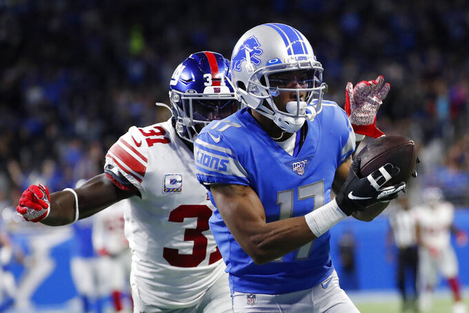 Detroit Lions wide receiver Marvin Hall (17), chased by New York Giants defensive back Michael Thomas (31), catches a 49-yard pass for a touchdown during the first half of an NFL football game, Sunday, Oct. 27, 2019, in Detroit. (AP Photo/Rick Osentoski)
