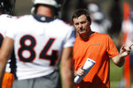 Denver Broncos offensive coordinator Rich Scangarello directs tight end Troy Fumagalli (84) during drills at the team's NFL football training camp Friday, July 19, 2019, in Englewood, Colo. (AP Photo/David Zalubowski)