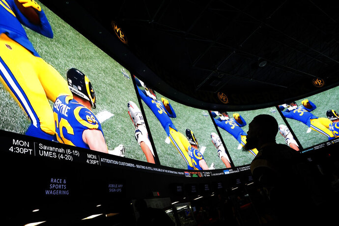 A man watches Super Bowl LIII at the Westgate Superbook sports book, Sunday, Feb. 3, 2019, in Las Vegas. (AP Photo/John Locher)