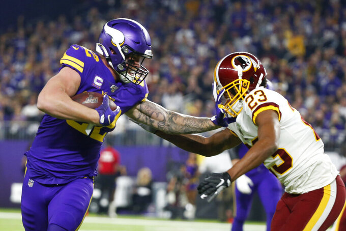 Minnesota Vikings tight end Kyle Rudolph, left, runs from Washington Redskins cornerback Quinton Dunbar, right, after catching a pass during the first half of an NFL football game, Thursday, Oct. 24, 2019, in Minneapolis. (AP Photo/Bruce Kluckhohn)