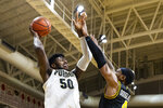Purdue forward Trevion Williams (50) shoots over Virginia Commonwealth forward Corey Douglas (4) in the first half of an NCAA college basketball game at the Emerald Coast Classic in Niceville, Fla., Friday, Nov. 29, 2019. (AP Photo/Mark Wallheiser)