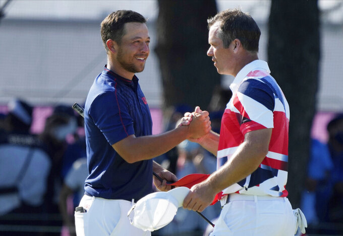 CORRECTS LAST NAME TO SCHAUFFELE FROM SHAUFFELE -  Xander Schauffele of the United States, left, is congratulated by Paul Casey of Britain after winning gold in the men's golf event at the 2020 Summer Olympics on Sunday, Aug. 1, 2021, in Kawagoe, Japan. (AP Photo/Andy Wong)