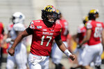 Maryland quarterback Josh Jackson reacts after throwing a touchdown pass to Tyler Mabry during the first half of an NCAA college football game against Howard, Saturday, Aug. 31, 2019, in College Park, Md. (AP Photo/Julio Cortez)