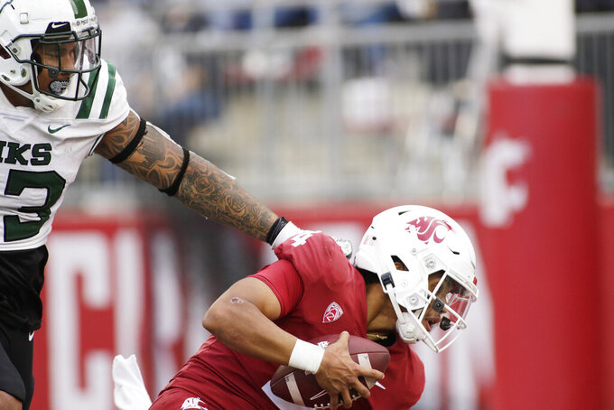 Portland State defensive tackle VJ Malo, left, sacks Washington State quarterback Jayden de Laura during the second half of an NCAA college football game, Saturday, Sept. 11, 2021, in Pullman, Wash. (AP Photo/Young Kwak)