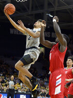 Colorado guard Daylen Kountz drives past Loyola Marymount guard Eli Scott during the first half of an NCAA college basketball game Wednesday, Dec. 4 2019, in Boulder, Colo. (AP Photo/Cliff Grassmick)