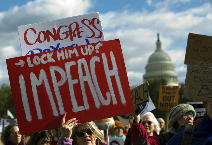 Demonstrators march on Pennsylvania Avenue protesting President Donald Trump, in Washington, Friday, Nov. 8, 2019. (AP Photo/Jose Luis Magana)