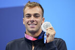 Gregorio Paltrinieri of Italy poses with his silver medal for the men's 800-meters freestyle final at the 2020 Summer Olympics, Thursday, July 29, 2021, in Tokyo, Japan. (AP Photo/Matthias Schrader)