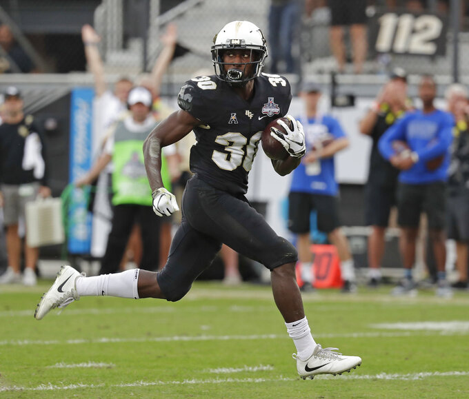 Mack shines, No. 7 UCF beats Memphis 56-41 for AAC title
