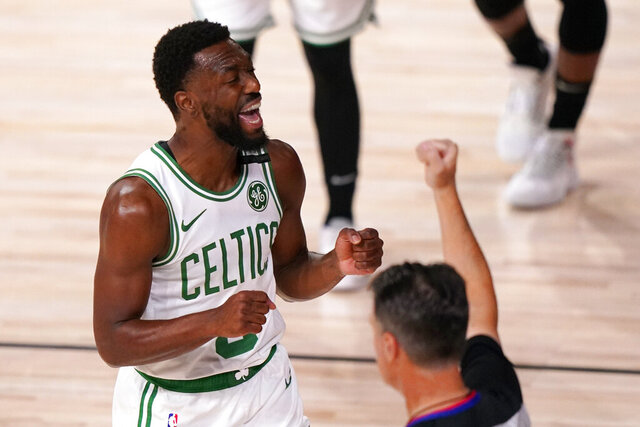 Boston Celtics' Kemba Walker (8) reacts to being called for a foul during the first half of an NBA conference final playoff basketball game against the Miami Heat Sunday, Sept. 27, 2020, in Lake Buena Vista, Fla. (AP Photo/Mark J. Terrill)