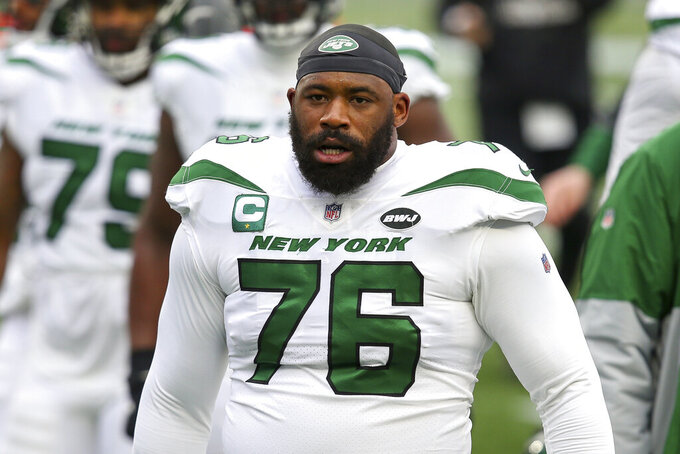 FILE - In this  Jan. 3, 2021, file photo, New York Jets offensive tackle George Fant (76) walks off the field before an NFL football game against the New England Patriots in Foxborough, Mass. The Jets activated Fant from the reserve/COVID-19 list on Friday, Aug. 6, 2021. (AP Photo/Stew Milne, File)